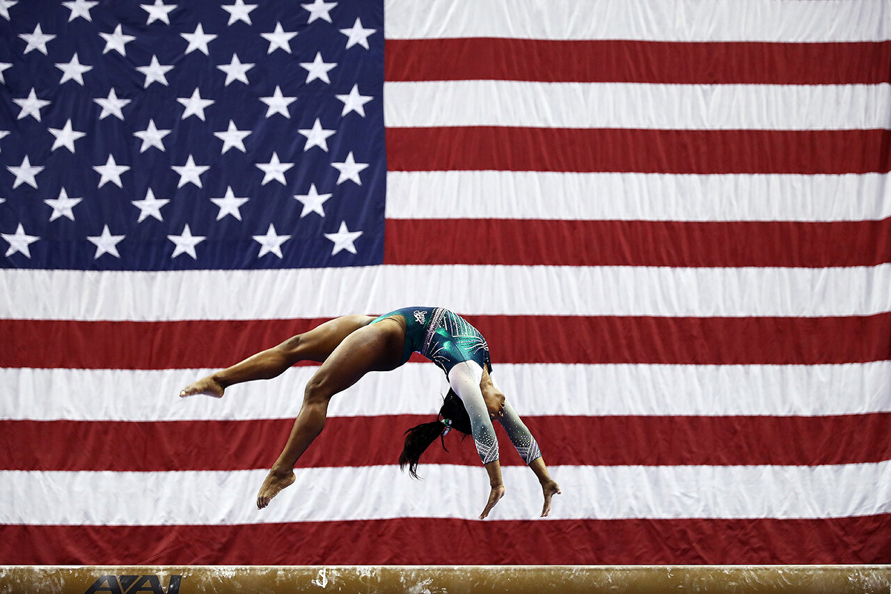 Simone Biles competes on the balance beam during the senior women's competition at the U.S. Gymnastics Championships in Kansas City, Mo.