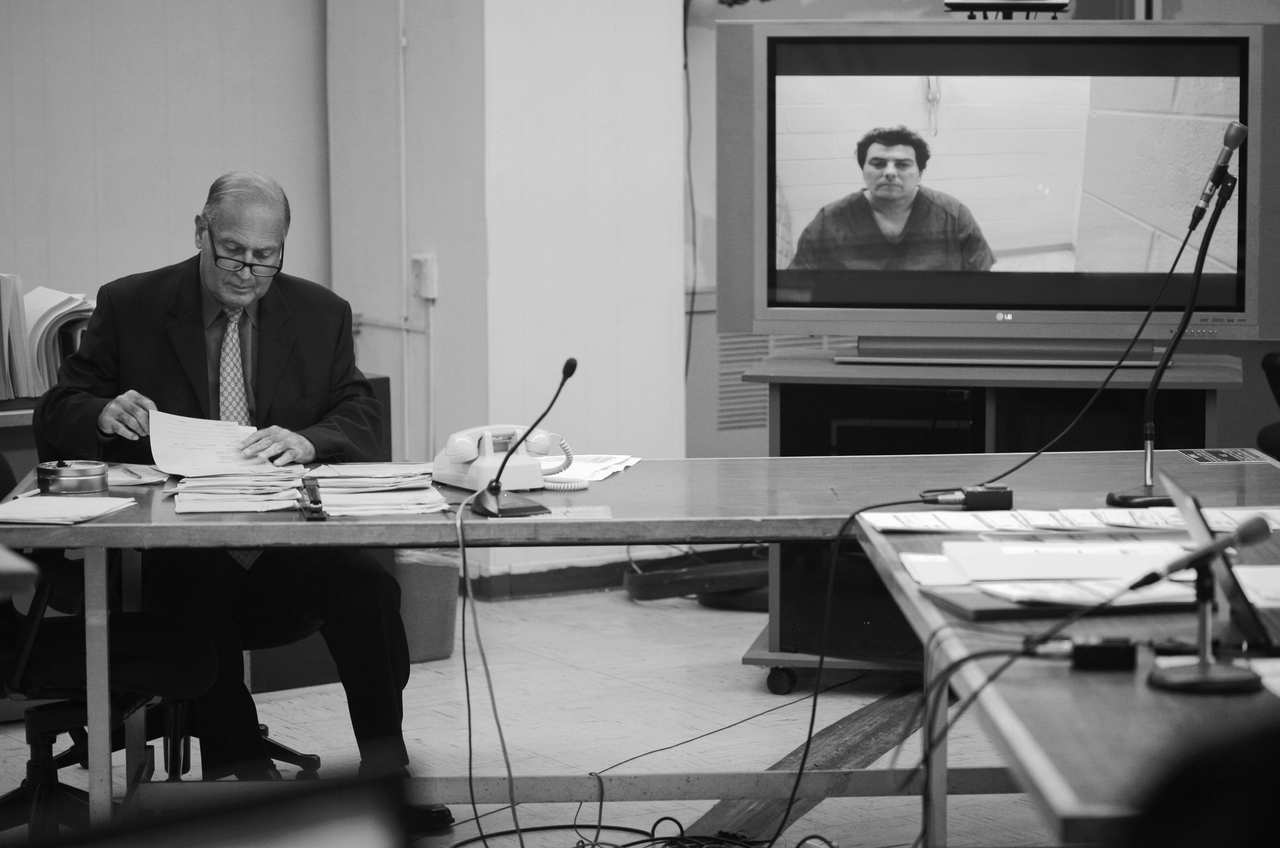 Frank Gonzalez, assistant deputy public defender in Hudson County, represents a defendant during CJP via video hookup from the Hudson County Correctional Facility.