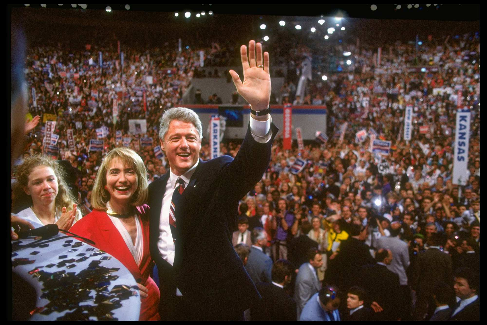 Presidential-nominee Bill Clinton waves to the crowd on the floor of Democratic National Convention with his wife Hillary Rodham Clinton and daughter Chelsea by his side. | <span>Steve Liss/The LIFE Images Collection/Getty Images</span>