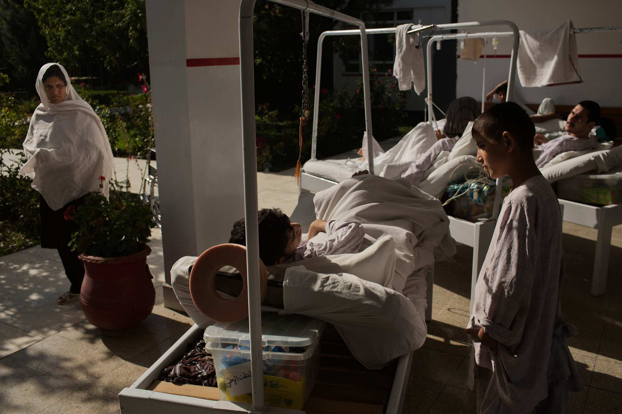Patients spend time outside their wards to get some air and sunlight at Emergency Surgical Center.