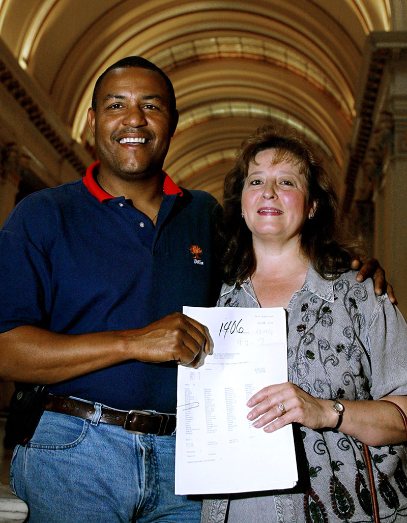 Thomas and Gail Webb in 2003 hold a copy of a bill that gives wrongfully convicted and imprisoned people the right to apply for compensation from the state of Oklahoma.