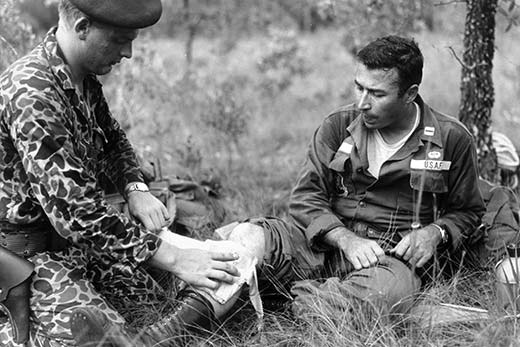 A wounded Captain Grimes being treated by an international partner.