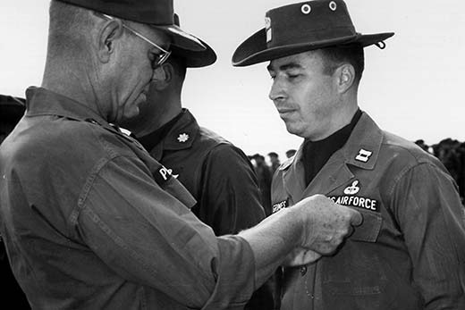 Captain Grimes receives the Bronze Star.